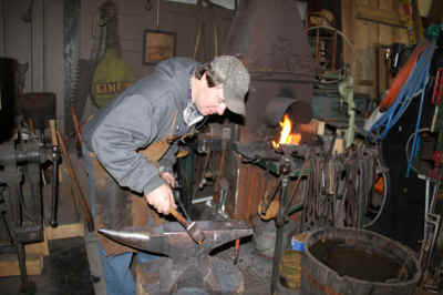 Blacksmith working on door latch