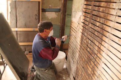 Mike repairing west ell wall lath.