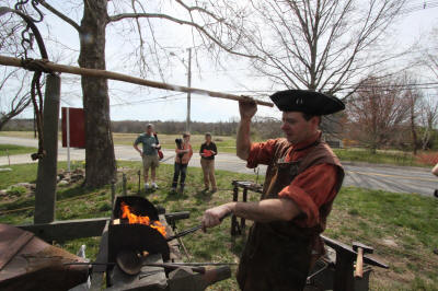 Blacksmith Carl Close demonstrates.
