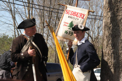Sudbury Minute Men with banner.